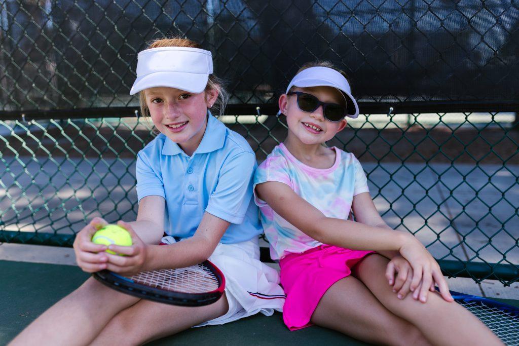 Girls taking a break from tennis